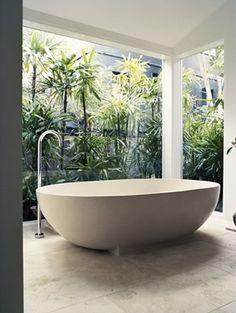 Beautiful, lush bathroom w/ giant bath tub