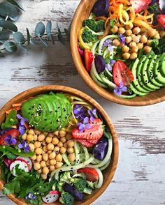 food-without-regrets: We have carrot noodles, cucumber noodles, broccoli, chickpeas, strawberries, garden harvested violets, parsley, radish, avocado, purple potato, seeds and sweet date-lime dressing