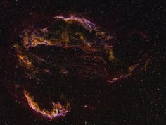These wisps of gas are all that remain visible of a Milky Way star. Many thousands of years ago that star exploded in a supernova leaving the Veil Nebula. The supernova remnant lies about 1400 light-years away and covers over five times the size of the full Moon.