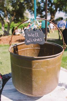 have guests leave well wishes as guest book in old well #wellwishes #guestbook #weddingchicks http://www.weddingchicks.com/2014/03/17/central-coast-summer-wedding/