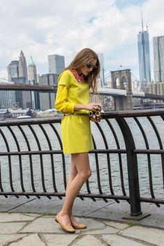 Olivia Palermo wearing Kate Spade New York Dawn Dress in Moonshine/bazooka pink, Rafe Lizelle Oval Minaudiere, Wunderkind Turquoise Ocelot Sunglasses, New Yok City. August 2013