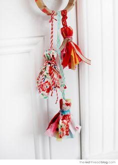 the red thread fabric tassels hanging