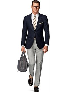 """Summer weight, wool silk blend by Ferla. Fabric is an open weave. This would make a great 2nd blue blazer after the primary smooth fabric type. Something about this jacket I really like... must be the color and the weave... it just screams """"summer cool""""."""