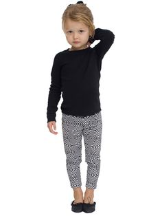 """Kids Printed Cotton Spandex Jersey Legging  Rating  Reviews (0)  Color: Crème Navy Stripe  Size: Please Select  2 Years  4 Years  6 Years  Size Chart  Quantity  Price  $16.50  Locate This Item at a Nearby Store  Share  Add to Wish List  Comfortable printed leggings perfect worn as pants, or layered under skirts and dresses.    Cotton/Spandex Jersey (95% Cotton / 5% Elastane) construction  Approximately 13 1/2"""" inseam (34.3cm)  Elastic waistband  Form-fitting  Not intended for sleepwear"""