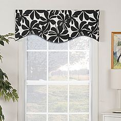 @Overstock - This valance showcases a contemporary fan floral print in classic black and white.  This lined valance has an 'M' shape design and is accented with coordinating black cord.  http://www.overstock.com/Home-Garden/Swirl-Print-Shaped-Valance/5400789/product.html?CID=214117 $32.99