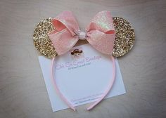 Oh my! These gold glitter Minnie Mouse Ears will make a chic statement for your little lady! Adorned with a sparkly pin bow with a rhinestone buckle center. So fancy! Perfect accessory for a birthday party or simply a trip to Disney any time of the year! Recommended for ages 12