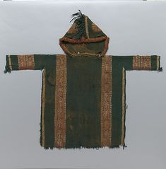 Child's Tunic with Hood    Object Name:      Tunic  Date:      430–620 AD  Geography:      Egypt  Medium:      Tapestry weave in purple-colored, red-brown, and undyed wool on plain-weave ground of green wool; fringes in green and red-brown along the perimeter of the hood and lower edges   Dimensions:      Textile (Including sleeves and hood): H. 35 1/16 in. (89.1 cm) W. 39 3/4 in. (101 cm)  Classification:      Textiles  Credit Line:      Gift of George D. Pratt, 1927  Accession Number…