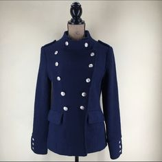 """Pink MartiniMilitary Style Coat Vintage inspired military style coat by Pink Martini. Can be buttoned to create multiple looks. Fitted, very flattering fit! Navy with vibrant lime green lining. 2 front pockets. High quality silver buttons-(grommeted on, not sewn). Size small. Sleeve length-24"""". Center back length-24"""". Shoulder to shoulder-14"""". Dress form bust size is 35"""" and this fits it comfortably with a little extra room. 70% Polyester 30% Wool. Hand wash or dry clean. Pink Martini…"""