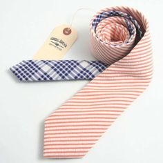 Roll this inside a box! Pick neckties that suit the guy! :)