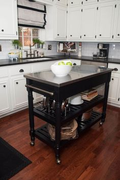 Clever Small Island Ideas for Your Kitchen (Photos) Small kitchen island cart on wheels with stainless steel top.Small kitchen island cart on wheels with stainless steel top. Kitchen Island On Wheels, Rolling Kitchen Island, Kitchen Island Table, White Kitchen Island, Kitchen Island With Seating, Kitchen Cabinets, Mobile Kitchen Island, Kitchen Dining, Island Bar