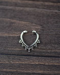 Made out of Alloy.  Can be worn with or without septum piercing and suitable for every individual.  Leave your PHONE NUMBER, it will help the courier