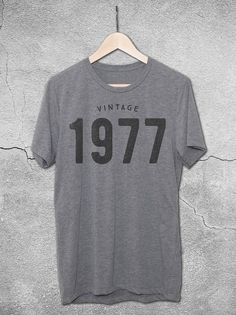 40th Birthday gift ideas! This unisex tees features the Vintage 1977 graphic printed on a soft vintage gray t-shirt. The perfect 40th birthday gift for men and women!