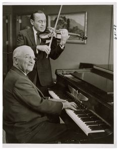 Photograph of President Harry S. Truman Playing the Piano While Jack Benny Plays the Violin, 09/03/1959.