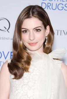 Anne Hathaway's Center Part Hairstyle  The recently-engaged star opted for a middle part and sleek, straight hairstyle when she walked the red carpet in this sleeveless Valentino Couture gown. While her simple hairstyle doesn't compete with gown's the exaggerated neckline, it does play up Hathaway's big, brown eyes and demure lip color.
