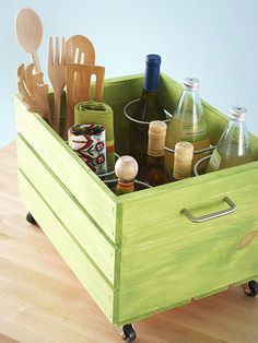Commandeer a wooden crate with a coat of paint, casters, and a cabinet pull to create a storage wonder on wheels. Inside, screw a metal wine...