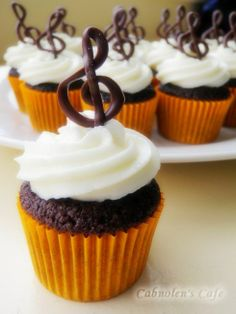 Chocolate Cupcakes with vanilla icing and chocolate treble clefs!