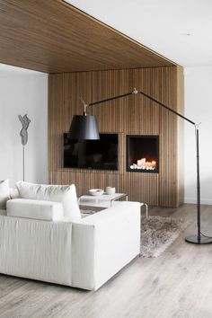 Apartment Cozy Fireplace Idea In The Living Room Use White Fabric Sofa Incredible Apartment Design For Book Lovers Modern Apartment Design, Apartment Interior, Modern Design, Timber Battens, Wood Slats, Wood Paneling, Black Floor Lamp, Floor Lamps, Living Spaces