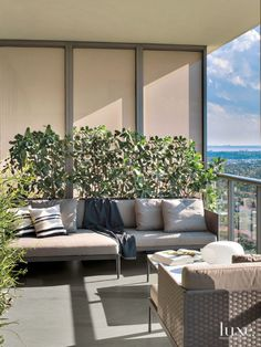 The owners and their neighbors bought and split the unit between their condos, resulting in enough extra terrace space for another lounge area off one of the guest bedrooms, which includes Roda's woven canvas belt seating from Luminaire. Outdoor Sofa, Outdoor Spaces, Outdoor Living, Outdoor Decor, Condo Balcony, Porch And Balcony, Plant Troughs, Cedar Paneling, Pergola Attached To House