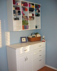 A Cozy Yarn Corner  After finding an old office mailbox at a local thrift store, baaramewe gave it a fresh coat of white paint and secured it to the wall of her crafts room. Voila -- a storage space for this knitter's yarn collection!