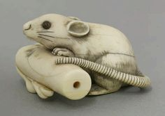 A good ivory Netsuke, first half of the 19th century, a rat peering over a fallen candle, finely incised black hair and inset horn eyes, signed Tomotada, 4.5cm