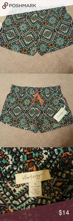 NWT Aztec Shorts Brand new, never worn! Size Medium. Perfect condition. Aztec lightweight shorts with orange and gray print. They arent see through! Bought from a small boutique! Not LuLaRoe  Smoke free home Ships same day or next day LuLaRoe Shorts