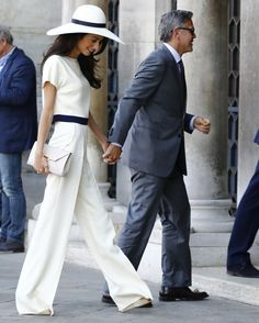 When George Clooney and Amal Alamuddin wed in a civil ceremony at Venice's town hall, the bride wore a short-sleeved white suit (designed by Stella McCartney), paired with a wide-brimmed hat. Amal Clooney, George Clooney, 30 Outfits, Cool Outfits, Fashion Outfits, Amal Alamuddin Style, Bridal Jumpsuit, Cooler Look, White Suits