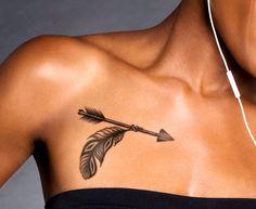 Beautiful arrow & feather tattoo