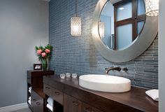 Transitional bathroom -- dark vanity, blue glass tile, wall mount faucet, vessel sink