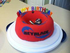 Beyblade stadium cake: bundt, fondant, sugar sheets, real beys
