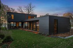 Sophisticated modern cabin in the Midwest captures serene lake views #house #modern #cabin