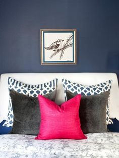 Hot pink is a great way to add a feminine touch to more masculine hues, like this bedroom's blue-black wall hue.