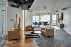 Polaris Partners - Boston Headquarters / Painted Drywall Bulkhead / Exposed Ceiling / Wood-Look Tile / Butt-Glazed Glass / Natural Light / Door Pull