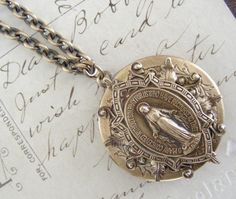 Blessed Virgin Mary Etched Locket Necklace- very similar to Virgin, Saints & Angels jewelry. So beautiful. Love this!!!
