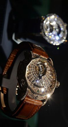 Graff watches. This is a beautiful watch.  I've seen this brand in real life.  Seriously I've never seen diamonds that boing like this band it's unbelievable.