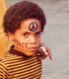 Lenny Kravitz | What a cute kid! (Not to mention a really cool photo!) Today, he's one of the few celebrities that makes me swoon. So handsome, so cool.