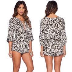 beautiful leopard print romper Super cute and chic leopard print romper. Has a super cute and sexy criss cross lace up v neck. Made out of chiffon polyester material. Super high quality material. Hand picked ❤️ Pants Jumpsuits & Rompers