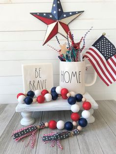 This Patriotic Farmhouse Bead Garland is great for 4th of July as well as Memorial Day or Veteran's Day. Or you can show your love for our country and have them out all year long. The garland is made up of handpainted wood beads on a jute rope with handmade ribbon and twine tassels. Including the tassels this garland is approx. 30 inches long. Wood Bead Garland, Diy Garland, Beaded Garland, Garlands, Christmas Bead Garland, Garland Ideas, Star Garland, Christmas Decor, Christmas Ornaments