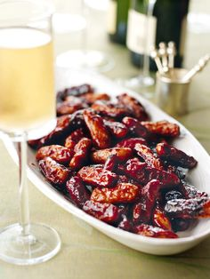 If you want to have something hot to pass around on a tray, then cocktail sausages are what you're after. There's nothing fiddly to make, nothing to go right or wrong, and everyone loves them. These are not just any cocktail sausages: the sesame oil, honey and soy give them a sweet-savoury stickiness that is pretty well impossible to resist.