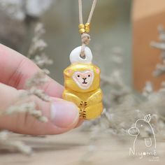 golden lucky monkey handmade necklace by niyome craft sold by niyome. Shop more products from niyome on Storenvy, the home of independent small businesses all over the world.