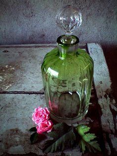 Top your antique dressing table with your favorite colors- mine of course are green and pink. Love the parfum bottle and the little rose.