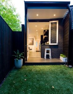 Minimalist Elegant Home Design in Black and White Colors Domination : West Street Home Exterior Design Among Wooden Fence Ideas Combined With Green Landscaping Decoration Design