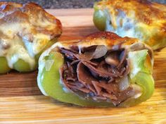Philly Cheesesteak Stuffed Peppers  INGREDIENTS  8 oz. Thinly Sliced Roast Beef  8 Slices Provolone Cheese  2 Large Green Bell Peppers  1 Medium Sweet Onion  6 oz. Baby Bella Mushrooms  2 Tbs. Butter  2 Tbs. Olive Oil  1 Tbs. Garlic - Minced  Salt and Pepper - to taste