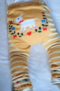 Little Lamb knit leggings (good head bands for infants too), and the shop is Penny & Tillie :)