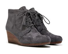 Take your style above and beyond with the Deluxe Wedge Bootie from Dr. Scholls(R).Synthetic suede upper in a wedge ankle bootie style with a round toeLace up front with tassel detailsStitching detailSmooth lining, cushioning insoleTPR outsole, 2 and 1/2 inch leather wrapped wedge heel