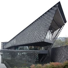 this museum in Xinjin, China, by Japanese architects Kengo Kuma and Associatesappears to be screened by rows of floating tiles.