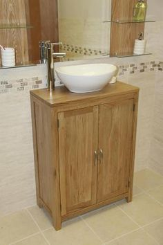 New addition recently in, Solid Oak Slimline Vanity unit, useful size for en suites, cloakrooms and small bathrooms. Complete with three internal oak shelves that can be adjusted (or even removed if so wished) and adds extra storage space within the ba Oak Vanity Unit, Oak Bathroom Vanity, Vanity Cabinet, Small Bathroom, Bathroom Ideas, Bathrooms, Extra Storage Space, Storage Spaces, Houses