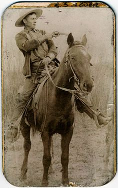 """onceuponatown: """" Outlaw Will Roberts, alias Dixon, cowboy train robber, seated on a horse, pointing a gun. Ca.1900. Photograph mounted on card from Pinkerton's National Detective Agency giving physical description and other information about..."""