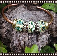 Emma's bead bakery uniques, just beautiful on the copper troll bangle ❤️ Ethnic look of green and cream by Deborah Taylor
