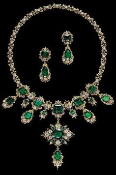 An antique gold, emerald and diamond parure, circa 1830, consisting of a necklace and a pair of earrings. from the Albion Art Collection -