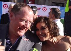 Terri Hatcher cozies up to John Lasseter at the premiere of Disney's Planes.